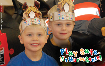 Two boys with 'horse' hats